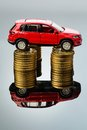 Rising motoring costs. car on coins Royalty Free Stock Images