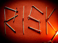 Risk concept with matches and flame Royalty Free Stock Photo