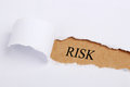 Risk concept torn paper with headline word Royalty Free Stock Photo