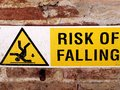 Risk of falling system symbol sign for danger on a wall Royalty Free Stock Photography