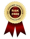 Risk free satisfaction guaranteed customer golden seal with text on center red maroon color shiny ribbons Stock Photography