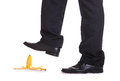 Risk man about to step on banana peel Royalty Free Stock Photos