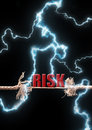 Risk thunder lightening bolts striking a breaking rope with the word Stock Photo
