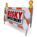 Risky investment warning sign barrier money management caution words on a or road construction to illustrate the need for in a Royalty Free Stock Photos
