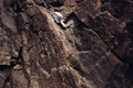 Risky man climbing over danger mountain without safety harness and rope Royalty Free Stock Photo
