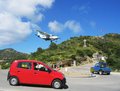 Risky plane landing at st barts airport french west indies january on january ft its runway is one of the shortest in Stock Photos