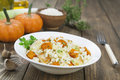 Risotto with chicken pumpkin and leek in a bowl on the table Royalty Free Stock Image