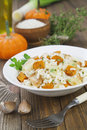 Risotto with chicken pumpkin and leek in a bowl on the table Royalty Free Stock Images