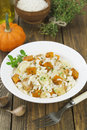 Risotto with chicken pumpkin and leek in a bowl on the table Stock Photo