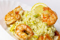 Risotto with fried prawns and avocado Royalty Free Stock Images