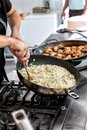 Risotto in a pan being cooked restaurant Royalty Free Stock Photography