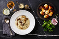 Risotto with porcini mushroom and raw mushrooms Royalty Free Stock Photo