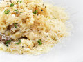 Risotto rice cooked with broth and sprinkled with cheese grated Stock Image