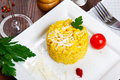 Risotto with saffron risotto alla milanese on a dish Royalty Free Stock Image