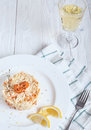 Risotto with shrimp and glass of white wine Royalty Free Stock Photo