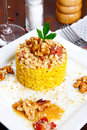 Risotto with walnuts saffron speck on a dish Stock Image