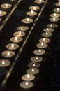 Ritual candles rows of in a church Royalty Free Stock Images