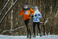 Rivalry between two young athletes on track of race ekaterinburg russia november during urban winter marathon Royalty Free Stock Photos