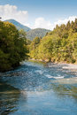 Rive wild river at the beautiful mountain valley Stock Photography