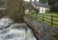 River angidy at tintern in spate with old cottages Stock Photography