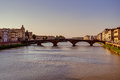 River arno in florence buildings alongside during dusk Royalty Free Stock Image