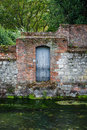 River bank with stone wall ancient and door on a in winchester hampshire uk Stock Images
