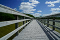 River Boardwalk under Blue Sky Royalty Free Stock Photo