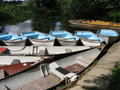 River boats a collection of rowing and punts resting on a in england Stock Photos