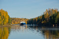 River cargo ship moving down the autumn morning Stock Photography