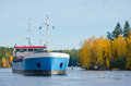 River cargo ship moving down the autumn morning Stock Photo