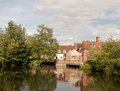 A river cottage scene in summer light in flatford mill near dedh Royalty Free Stock Photo