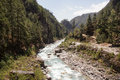 River cuts through mountains and forest everest base camp scenic nepal Stock Photography