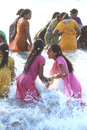 River dip women bathing themselves while fully dressed in india Royalty Free Stock Photography