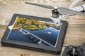 River diversion dam aerial view on a tablet reviewing picture of digital with drone propeller and radio control transmitter Royalty Free Stock Image