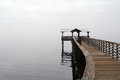 River dock on a foggy afternoon Royalty Free Stock Photo