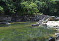 River in the dominican republic jungle small surrounded by rocks and ledges Stock Photography