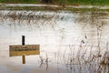 River flood waters submerge footpath Royalty Free Stock Photo