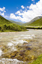 River flows in mountain against blue sky 2 Stock Images