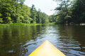 River kayak paddling on through woods Royalty Free Stock Photo