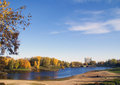 The river landscape at autumn and vividly coloured trees Stock Photography