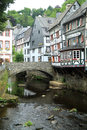 River Laufenbach flows right through the small city Monschau in Germany Royalty Free Stock Photo