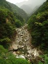 River in the mountains in japan japanese flowing through rocks Royalty Free Stock Photo