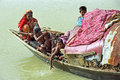 River nomads on their poor houseboat bangladesh charkajal island in the bay of bengal group portrait or family portrait of bengali Royalty Free Stock Image
