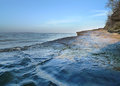 River or ocean background, waves with rocky shoreline Royalty Free Stock Photo