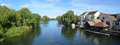 The river Ouse, Regatta meadows and riverside buildings at St Neots Cambridgeshire England. Royalty Free Stock Photo