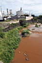 A river polluted with waste from a nearby factory Royalty Free Stock Photo