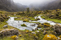River, rocks and clouds in Collanes Valley in El Altar volcano Royalty Free Stock Photo
