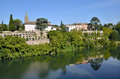 River tarn in the village of lisle sur tarn in france with church and arcades background commune department Stock Image