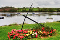 River Teifi with anchor and colourful flowers Royalty Free Stock Photography