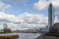 River thames at st george s wharf view along the south bank of the the new development in nine elms lambeth london Royalty Free Stock Photos